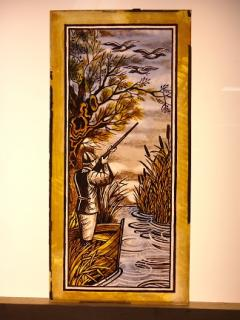 Antique stained glass hunting scene